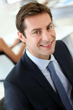 men in suits: Portrait of businessman wearing dark suit