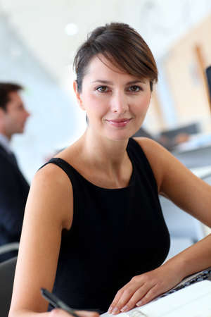 secretary desk: Businesswoman in office writing notes