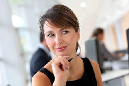ladylike: Portrait of businesswoman in office Stock Photo