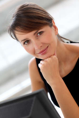 30 years old woman: Businesswoman in office working on desktop computer Stock Photo