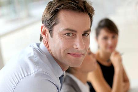 handsome old man: Smiling businessman attending work meeting