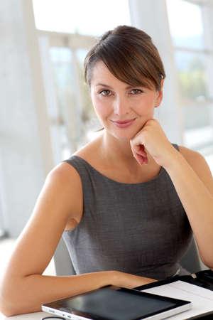 saleswoman: Portrait of serious businesswoman at work