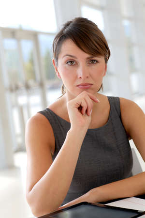 30 years old woman: Portrait of businesswoman with doubtful look Stock Photo