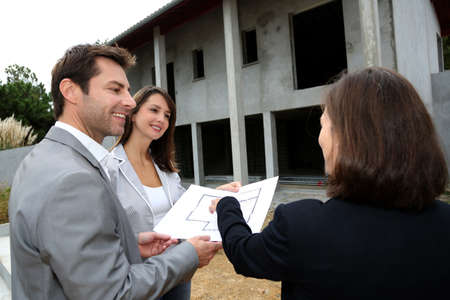 saleswoman: Couple meeting saleswoman on construction site