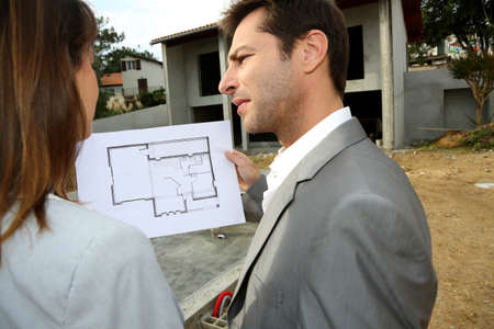 Couple on construction site checking building progress Stock Photo - 15831928