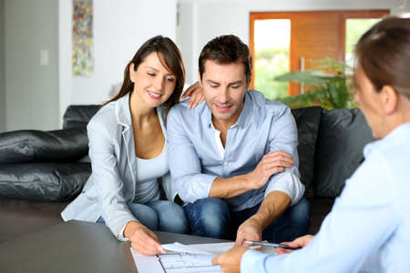 consulting: Couple meeting consultant for financial contract