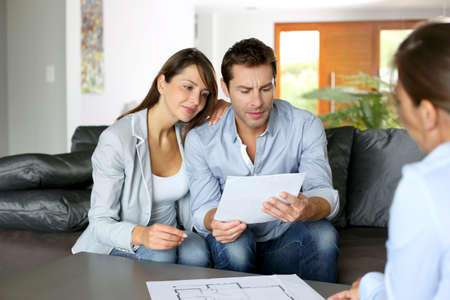building planners: Couple meeting consultant for financial contract