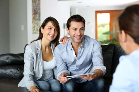 financial guidance: Couple meeting consultant for financial contract