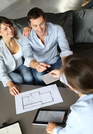 Couple signing financial terms for future property photo