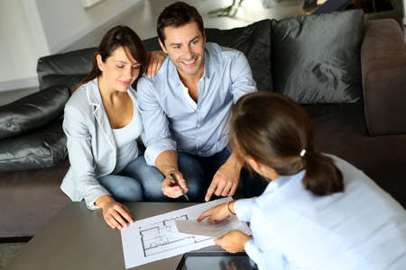 real estate planning: Couple signing financial terms for future property