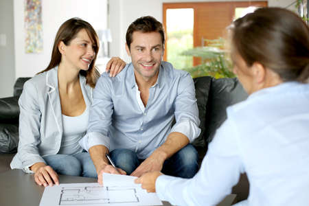 contracts: Couple signing financial terms for future property
