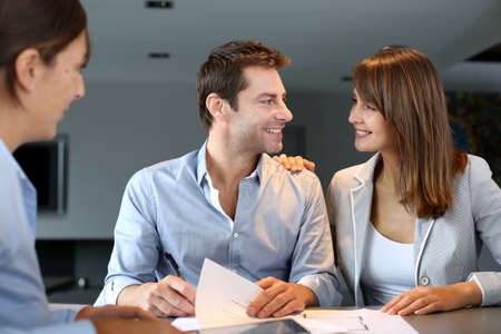 building planners: Couple meeting architect for plans of future home Stock Photo