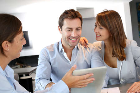 Couple meeting architect for plans of future home Stock Photo - 15832027