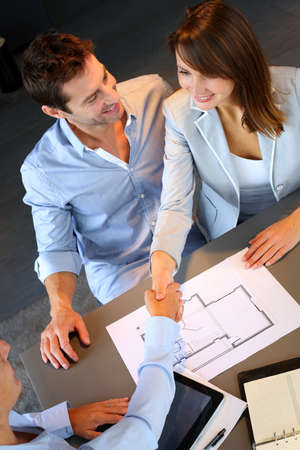 Couple concluding construction and financial contract photo