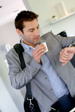 leaving: Businessman running late for work Stock Photo