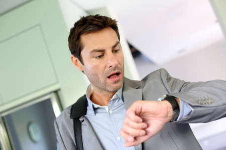 Businessman running late for work Stock Photo
