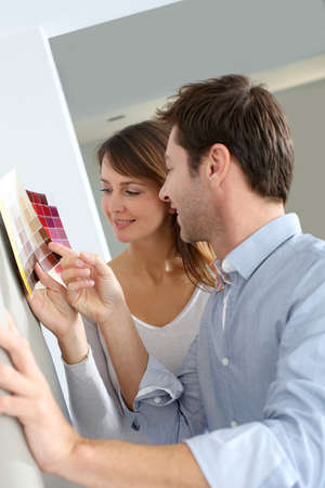 Couple choosing paperwall colour for their new home photo