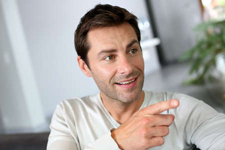 Portrait of man showing something with finger photo