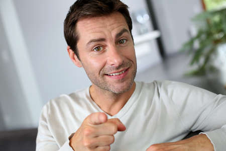 Man pointing finger towards camera photo