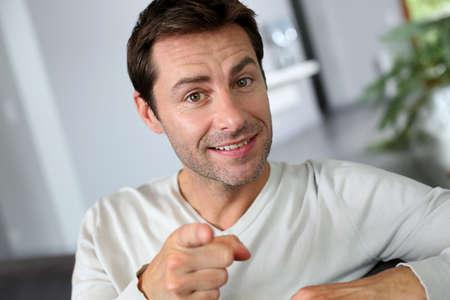 40 years old man: Man pointing finger towards camera