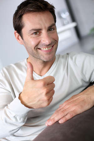 people attitude: Handsome man showing thumbs up