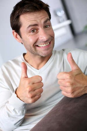 sit up: Handsome man showing thumbs up