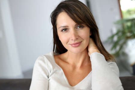 Portrait of attractive brunette woman looking at camera Stock Photo - 15831921