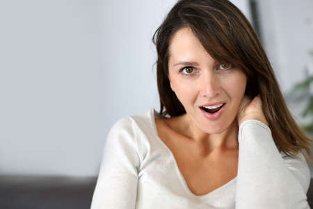 Woman with surprised expression on her face Stock Photo - 15831893