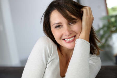 Portrait of attractive brunette woman looking at camera Stock Photo - 15831923