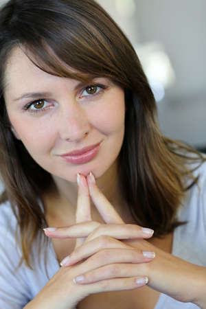 Attractive brunette woman with doubtful look Stock Photo - 15849337