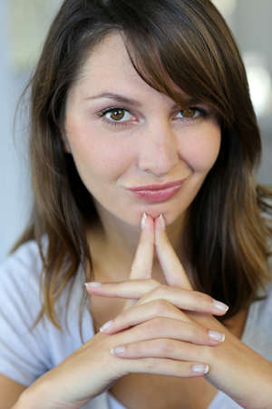 Attractive brunette woman with doubtful look  Stock Photo - 15849343