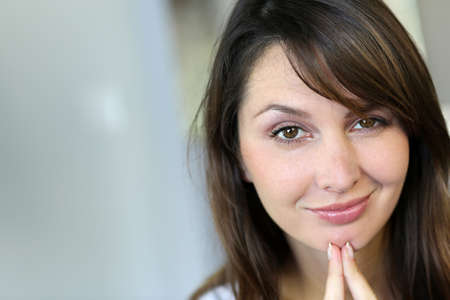 Attractive brunette woman with doubtful look Stock Photo - 15849301