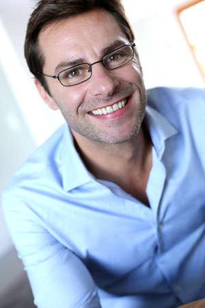 40 years old man: Smiling mature man wearing eyeglasses