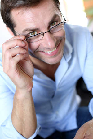 dark glasses: Smiling man with eyeglasses on Stock Photo