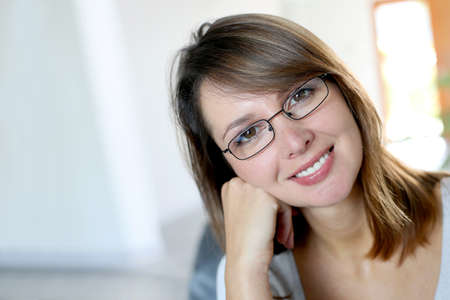 wearing glasses: Smiling brunette woman wearing eyeglasses