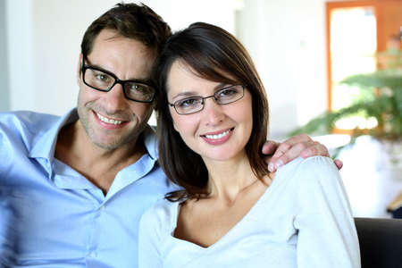 man with glasses: Smiling couple wearing eyeglasses