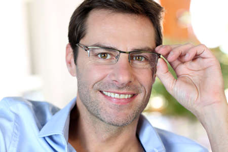 Portrait of middle-aged man with eyeglasses photo