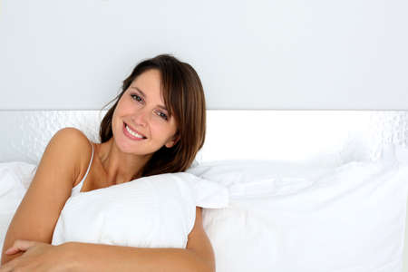 35 years old: Portrait of beautiful woman laying in bed