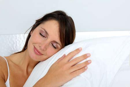 shut down: Woman feeling good asleep in bed Stock Photo