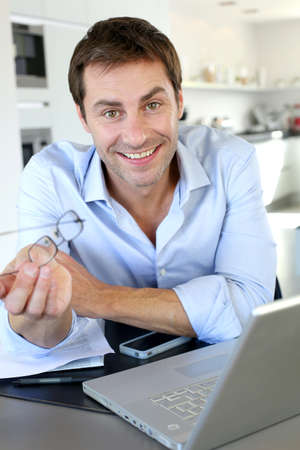 Portrait of businessman working from home Stock Photo - 15849368