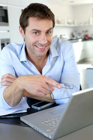 Portrait of businessman working from home Stock Photo - 15849393