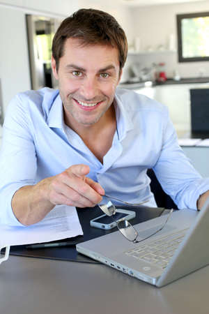 Portrait of businessman working from home Stock Photo - 15849369