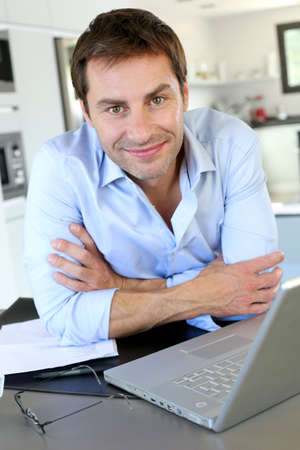 Portrait of businessman working from home Stock Photo - 15849367