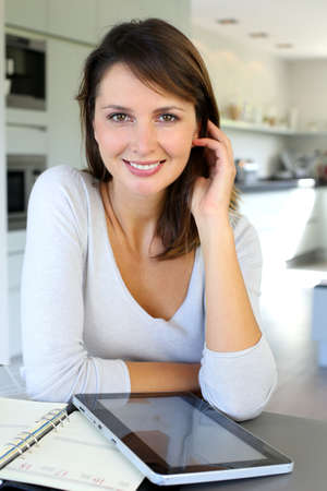 Beautiful teleworker working from home photo