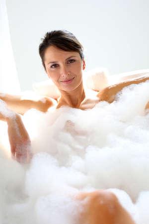 women bathing: Beautiful woman relaxing in bathtub Stock Photo
