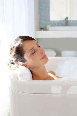 Beautiful woman relaxing in bathtub photo