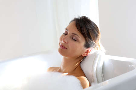 the bath: Beautiful woman relaxing in bathtub Stock Photo