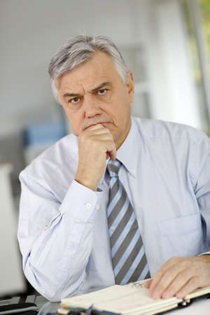 worried man: Senior businessman being serious in front of client