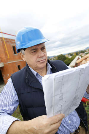 btp: Construction manager checking building project on site
