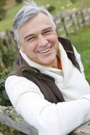 happy old man: Portrait of senior man standing in field